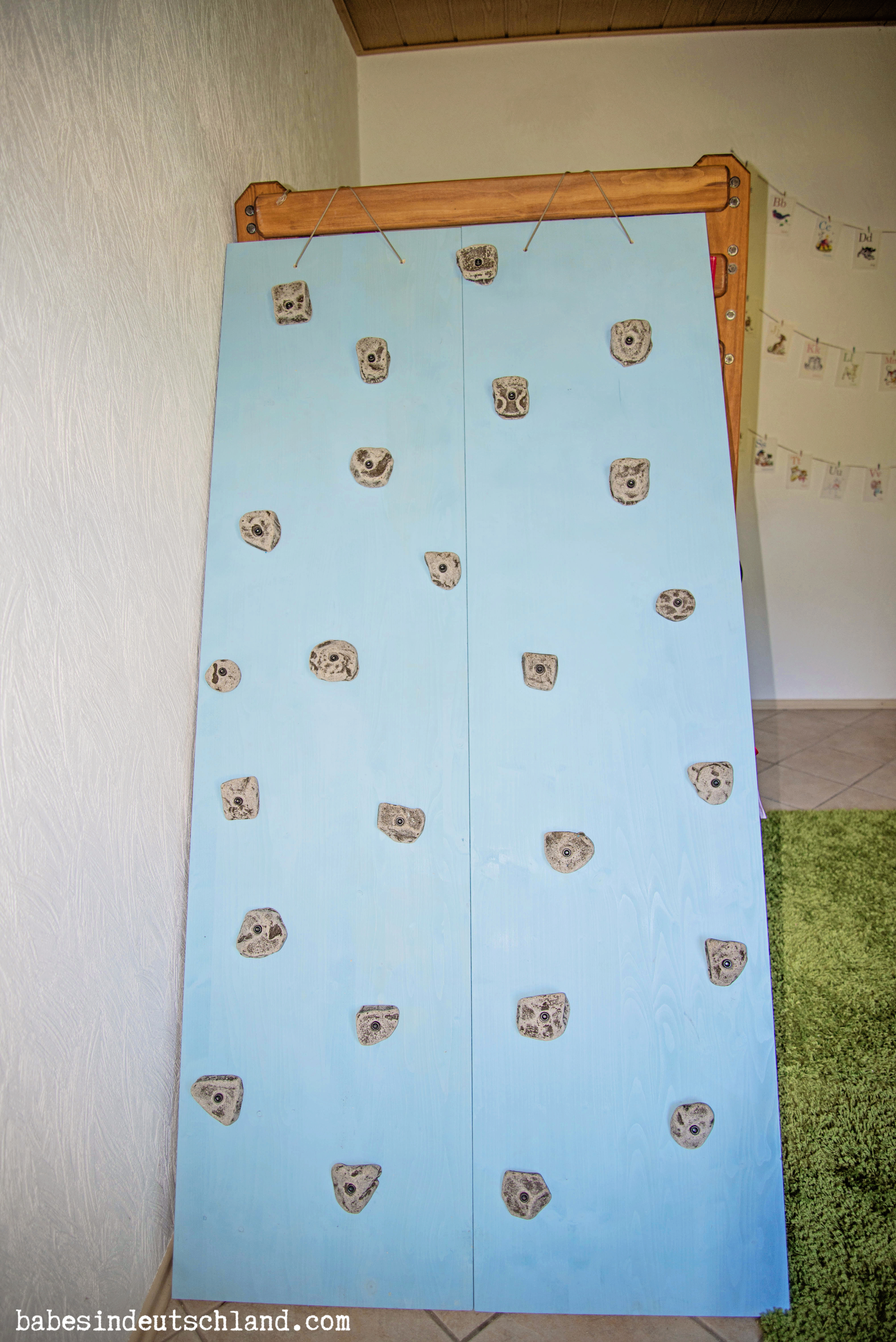 Babes in Deutschland, rock wall built on to a loft bed