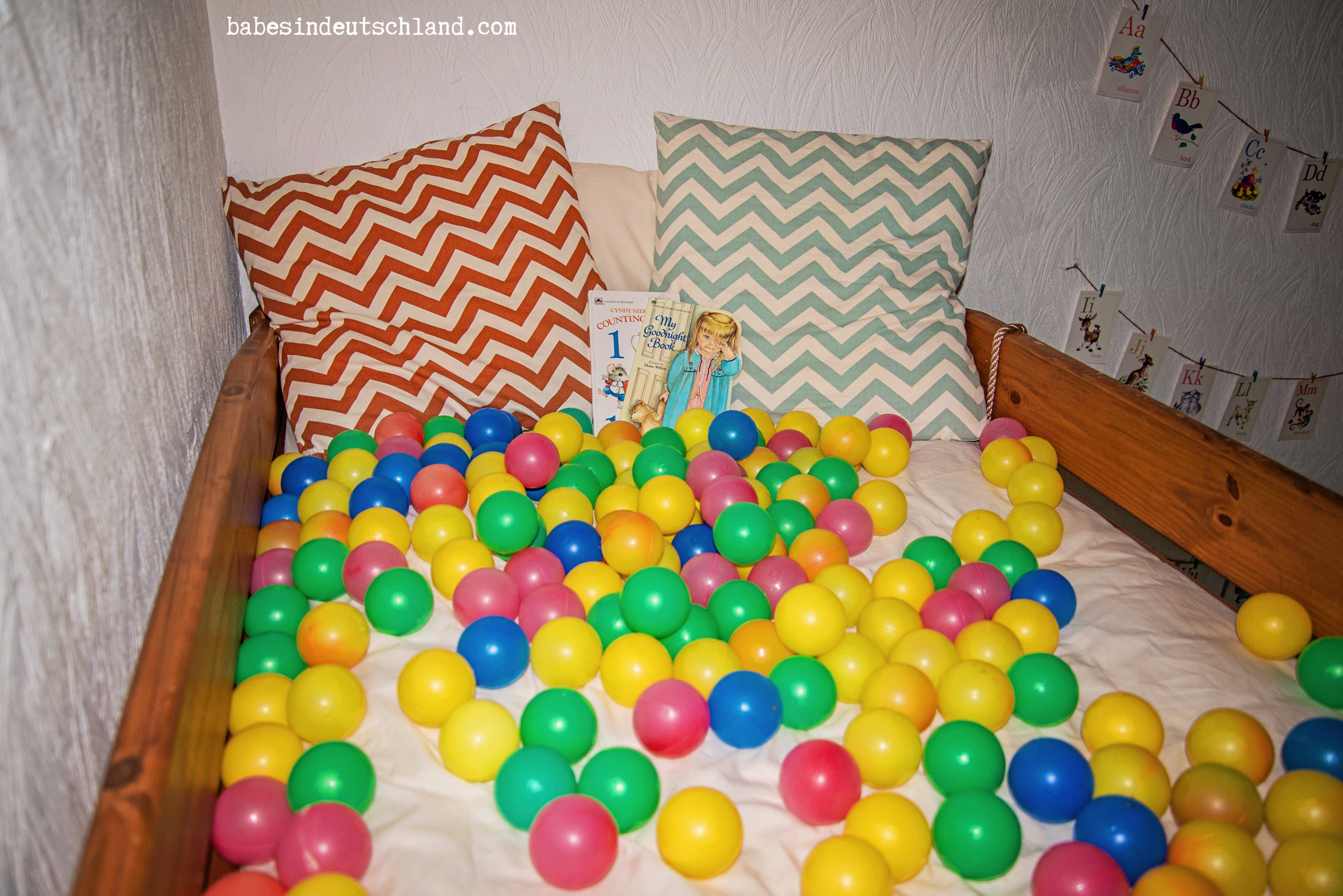 Babes in Deutschland, use a loft bed as a ball pit/reading nook!