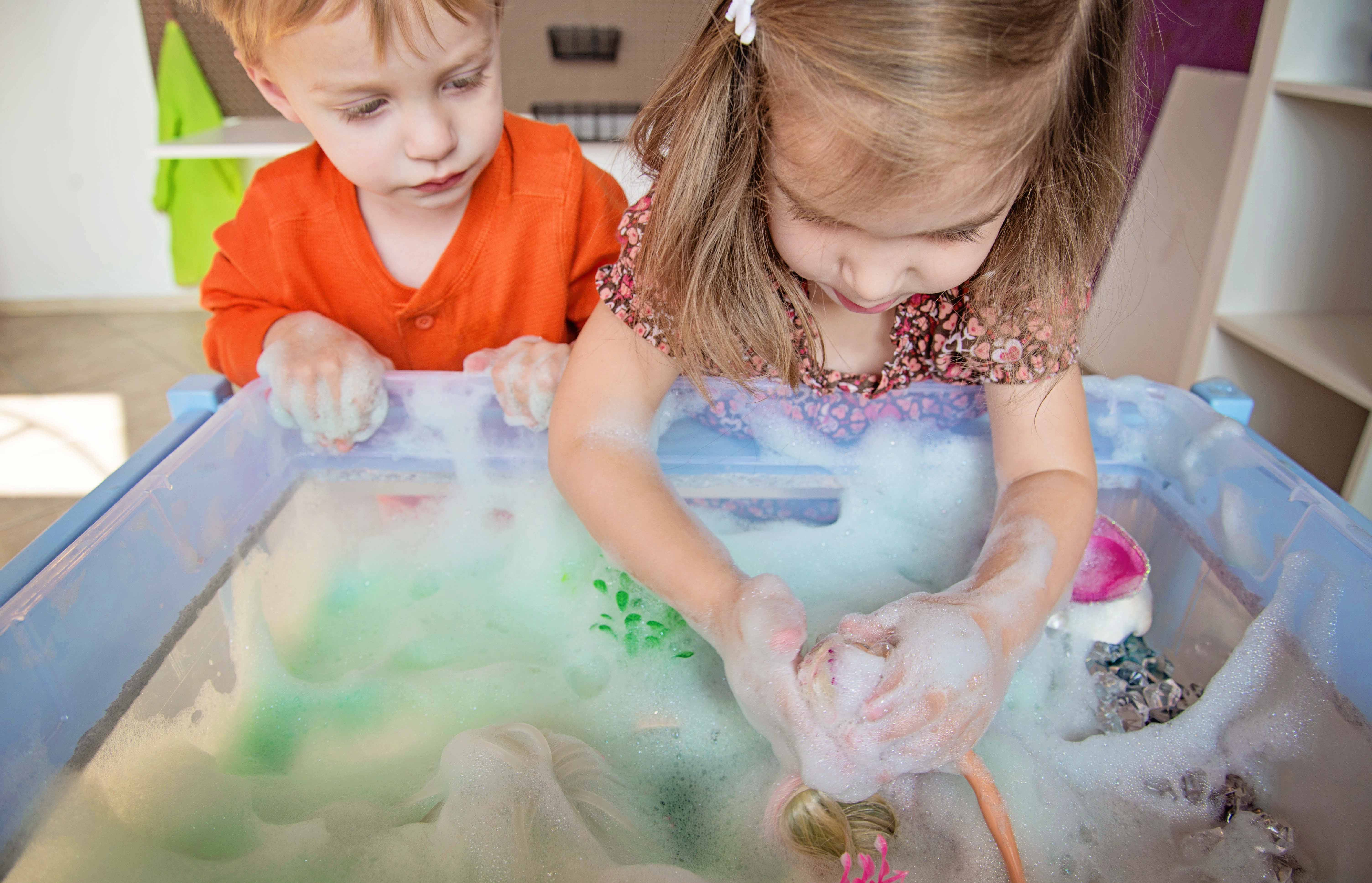 Babes in Deutschland, Mermaid lagoon sensory bin with colored soap foam!