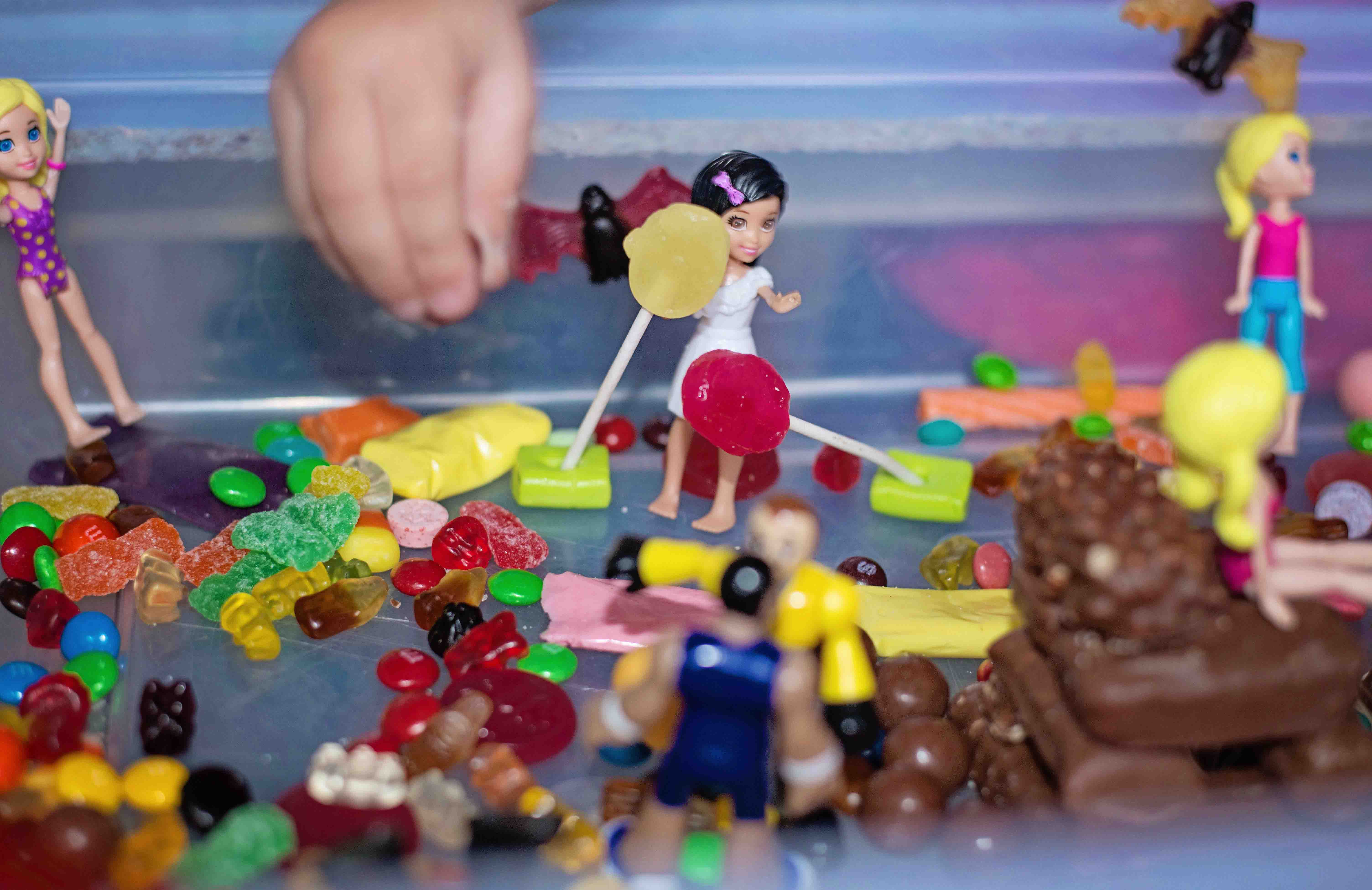 What are you going to do with all of that Halloween candy this year? Maybe you should, PLAY WITH IT!  We made a Candyland small world and saved ourselves a few cavities!