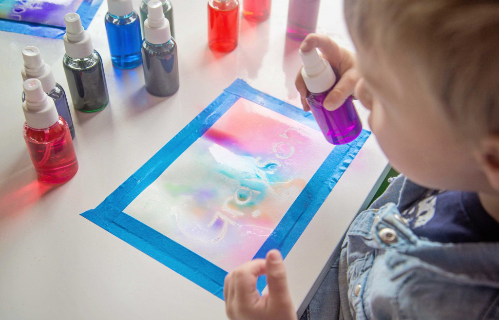 Make these DIY scented liquid watercolor spray paints with just three ingredients! You can use them for all sorts of art projects!