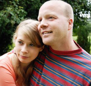 Dad and teen girl close