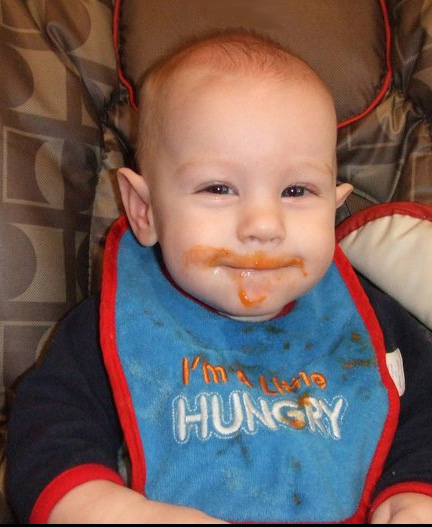 adorable baby boy eating carrots