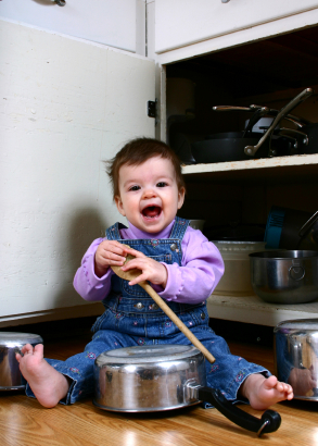 baby banging on pots and pans