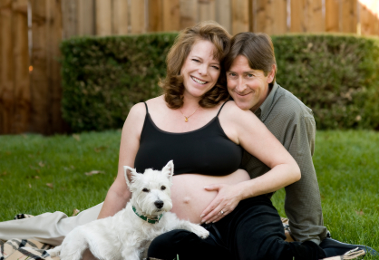 happy family with pregnant mom, dad and dog