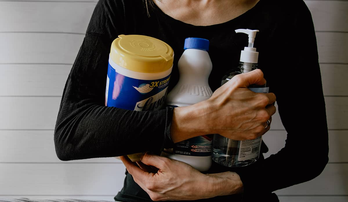 cleaning the house. an image showing a female holding cleaning supplies